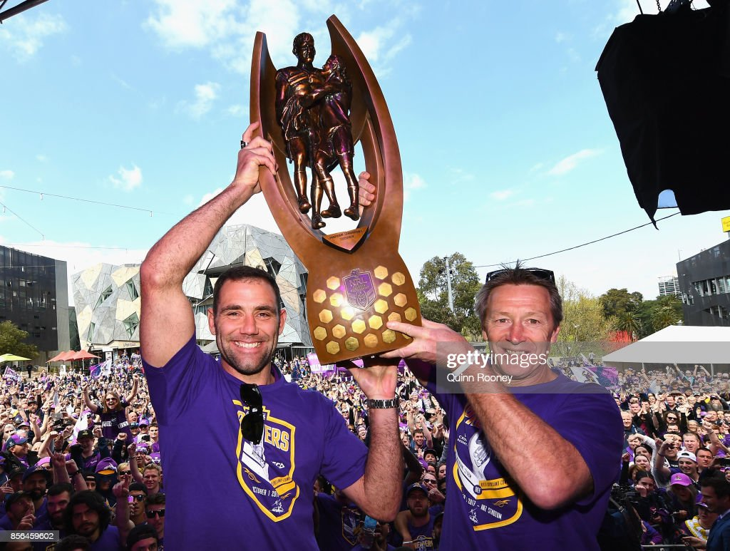 Cameron Smith and Craig Bellamy of the Storm hold up the NRL premiership trophy during the Melbourne Storm NRL Grand Final celebrations at Gosch's Paddock on October 2, 2017 in Melbourne, Australia.