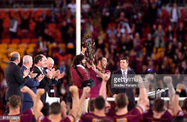 Cameron Smith and Johnathan Thurston of the Maroons hold up the shield as they celebrate victory after game three of the State Of Origin series...