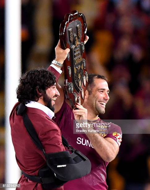 Cameron Smith and Johnathan Thurston of the Maroons hold up the Origin shield after game three of the State Of Origin series between the Queensland...