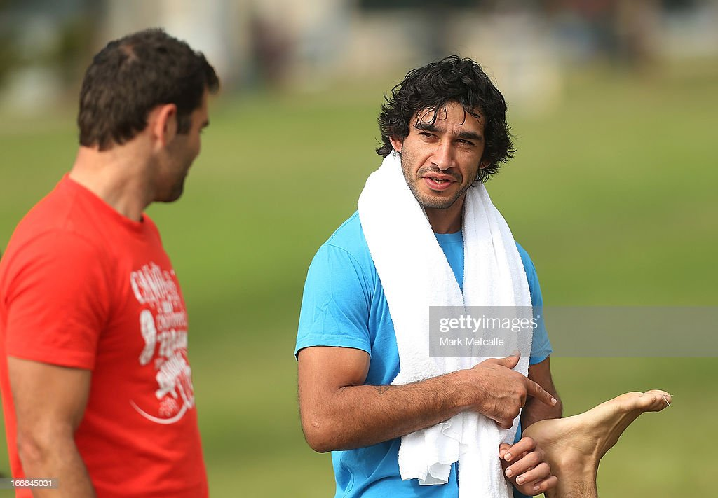 Cameron Smith and Johnathan Thurston talk during an Australian Kangaroos training session at Coogee Beach on April 15, 2013 in Sydney, Australia.