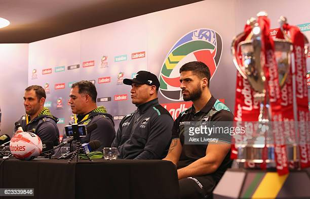 Cameron Smith and Mal Meninga of Australian Kangaroos sit alongside David Kidwell and Jesse Bromwich of New Zealand Kiwis during a press conference...