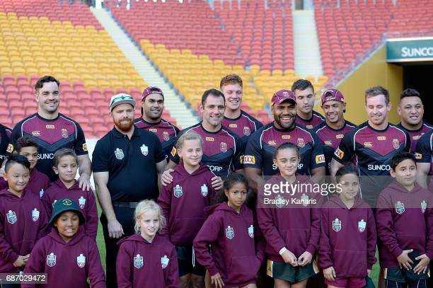 Cameron Smith and team mates pose with a group of children who played for the same junior club as Cameron Smith at Logan Brothers during a Queensland...