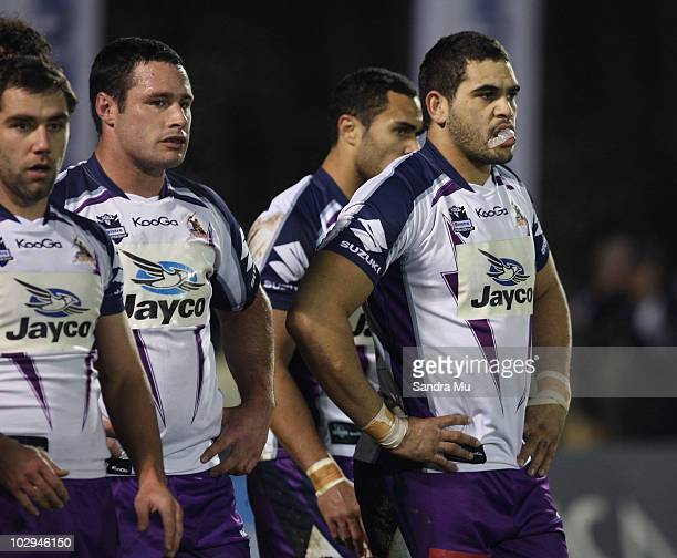Cameron Smith Brett White and Greg Inglis of the Storm reflect after the Warriors scored during the round 19 NRL match between the Warriors and the...