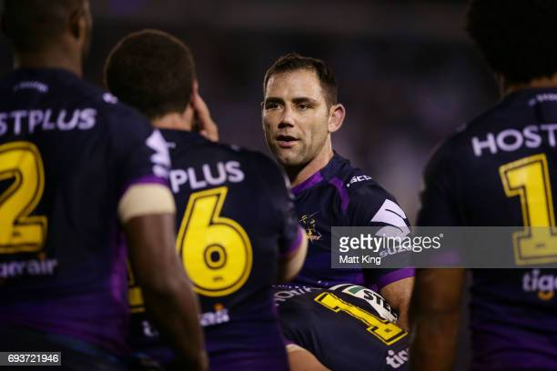 Cameron Smith captain of the Storm talks to players after a Sharks try during the round 14 NRL match between the Cronulla Sharks and the Melbourne...