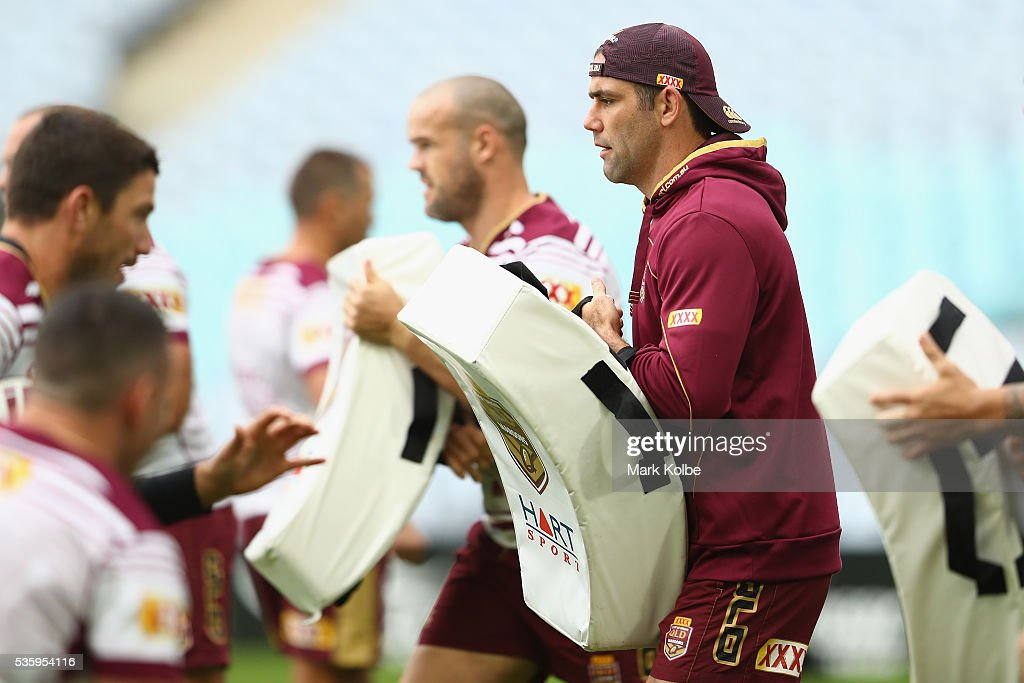 Cameron Smith holds a tackle shield during a Queensland Maroons State Of Origin captain's run at ANZ Stadium on May 31, 2016 in Sydney, Australia.