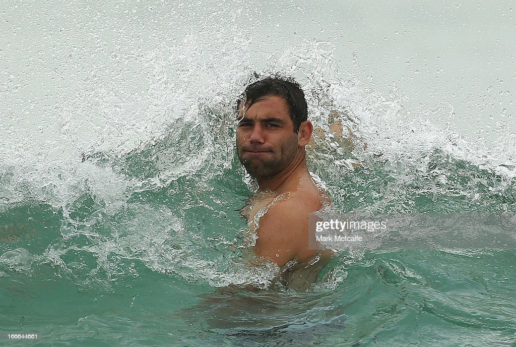 <a gi-track='captionPersonalityLinkClicked' href=/galleries/search?phrase=Cameron+Smith+-+Rugby+League+Player&family=editorial&specificpeople=453295 ng-click='$event.stopPropagation()'>Cameron Smith</a> is hit by a wave during an Australian Kangaroos training session at Coogee Beach on April 15, 2013 in Sydney, Australia.