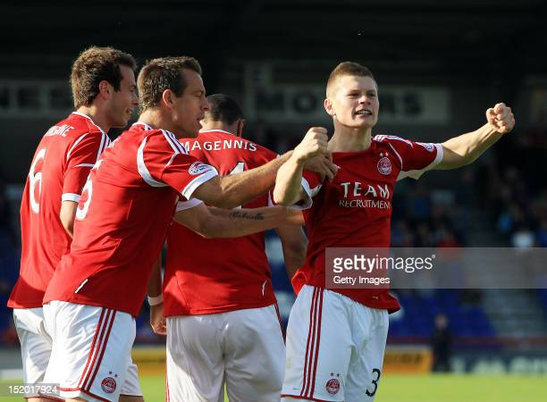 Cameron Smith of Aberdeen celebrates scoring during the Clydesdale Bank Scottish Premier League match between Inverness Caledonian Thistle and...