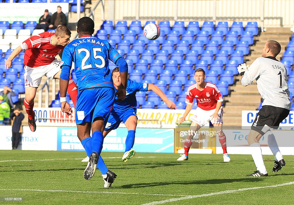 Cameron Smith of Aberdeen (L) scores during the Clydesdale Bank Scottish Premier League match between Inverness Caledonian Thistle and Aberdeen on September 15, 2012 in Inverness, Scotland.