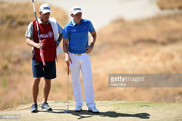 Cameron Smith of Australia and caddie Dan Quinn wait on the 13th green during the final round of the 115th US Open Championship at Chambers Bay on...