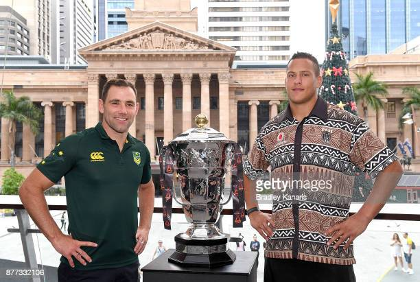 Cameron Smith of Australia and Kane Evans of Fiji pose with the World Cup trophy during a Rugby League World Cup Civic Reception at King George...