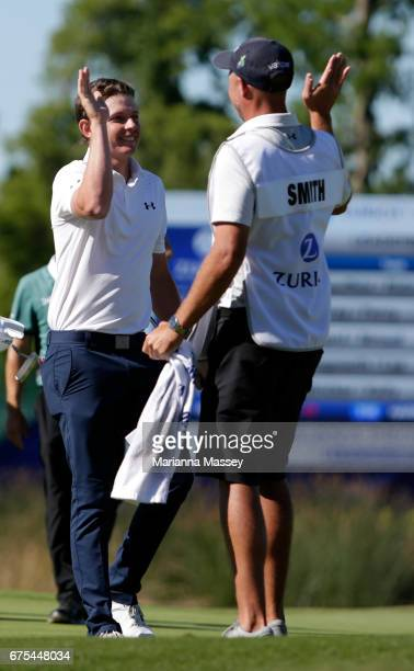 Cameron Smith of Australia celebrates with his caddie after putting in to win in a suddendeath playoff during a continuation of the final round of...