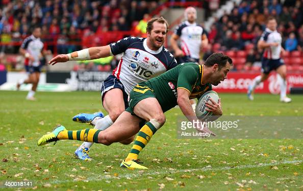 Cameron Smith of Australia dives over the line ahead of Clint Newton of USA to score his try during the Rugby League World Cup Quarter Final match...