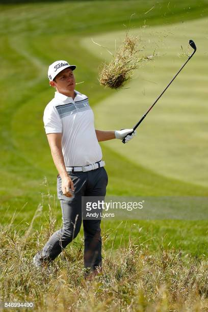 Cameron Smith of Australia hits his second shot on the third hole during the first round of the BMW Championship at Conway Farms Golf Club on...