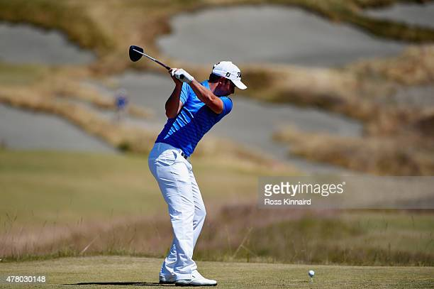 Cameron Smith of Australia hits his tee shot on the fourth hole during the final round of the 115th US Open Championship at Chambers Bay on June 21...