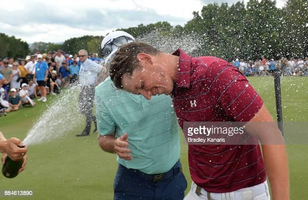 Cameron Smith of Australia is sprayed with champagne as he celebrates victory with his father Des during day four of the 2017 Australian PGA...