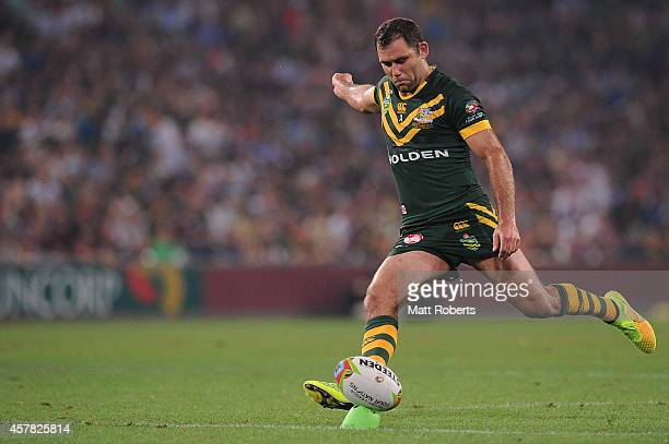Cameron Smith of Australia kicks a conversion attempt during the Four Nations Rugby League match between the Australian Kangaroos and New Zealand...