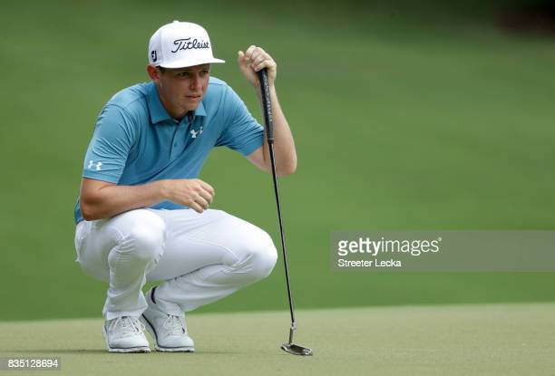 Cameron Smith of Australia lines up a putt on the first hole during the second round of the Wyndham Championship at Sedgefield Country Club on August...