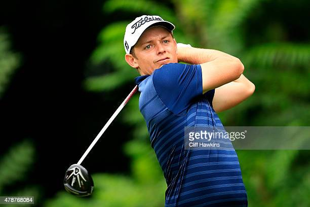 Cameron Smith of Australia plays his shot from the 12th tee during the third round of the Travelers Championship at TPC River Highlands on June 27...