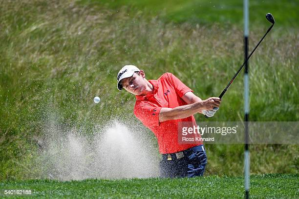Cameron Smith of Australia plays his shot out of the bunker on the fifth hole during a practice round prior to the US Open at Oakmont Country Club on...