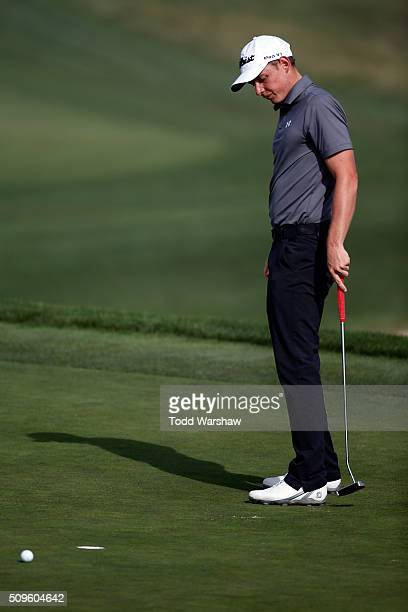 Cameron Smith of Australia reacts to a missed birdie putt on the 12th green during the first round of the ATT Pebble Beach National ProAm at the...