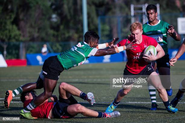 Cameron Smith of Hong Kong is tackled by Lahiru Herath Mudiyanselage of Sri Lanka during the Asia Rugby U20 Sevens 2017 at King's Park Sports Ground...