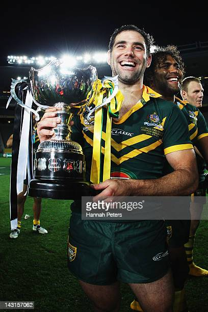 Cameron Smith of the Kangaroos holds up the trophy after winning the ANZAC Test match between the New Zealand Kiwis and the Australian Kangaroos at...