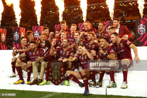 Cameron Smith of the Maroons and team mates celebrate winning game three of the State Of Origin series between the Queensland Maroons and the New...