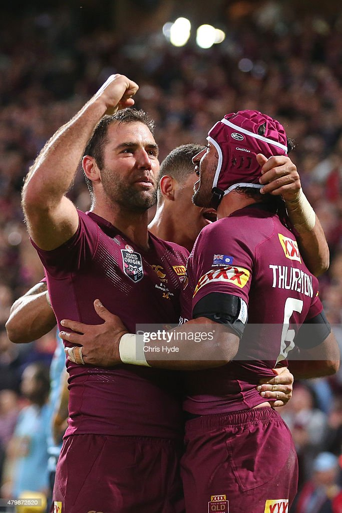 Cameron Smith of the Maroons celebrates a try by Darius Boyd during game three of the State of Origin series between the Queensland Maroons and the...