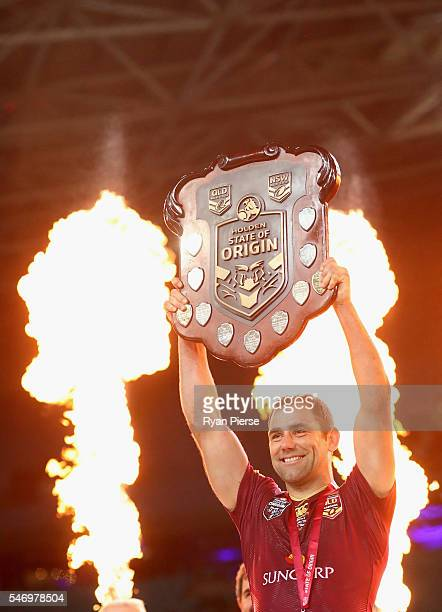 Cameron Smith of the Maroons celebrates with the trophy during game three of the State Of Origin series between the New South Wales Blues and the...