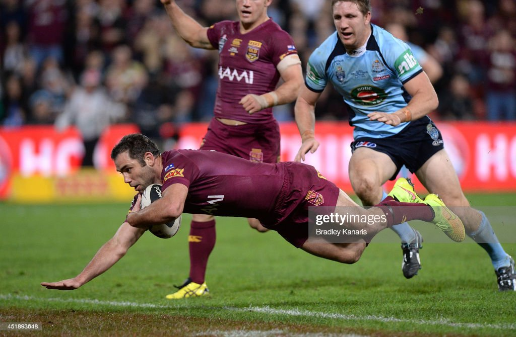 Cameron Smith of the Maroons dives over to score a try during game three of the State of Origin series between the Queensland Maroons and the New...