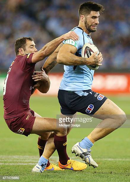 Cameron Smith of the Maroons tackled James Tamou of the Blues during game two of the State of Origin series between the New South Wales Blues and the...