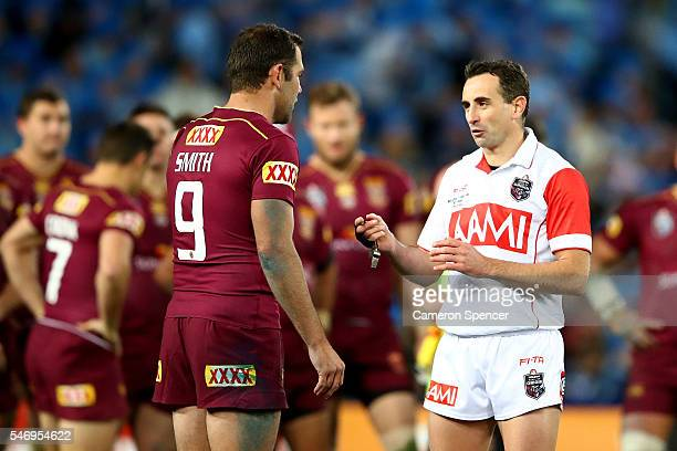 Cameron Smith of the Maroons talks to match referee Gerard Sutton during game three of the State Of Origin series between the New South Wales Blues...