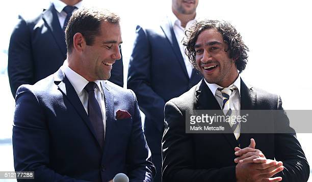 Cameron Smith of the Storm and Cowboys captain Johnathan Thurston share a joke on stage during the 2016 NRL Season Launch at Sydney Botanical Gardens...