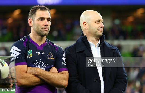 Cameron Smith of the Storm and Todd Greenberg Chief Executive Officer of the National Rugby League look on after the round 26 NRL match between the...