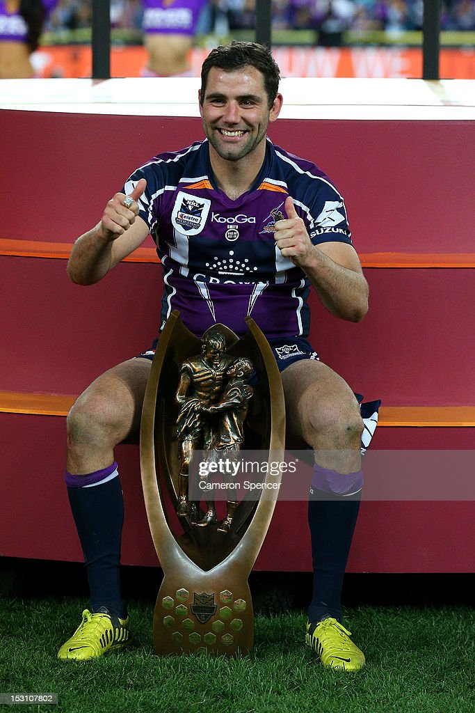 <a gi-track='captionPersonalityLinkClicked' href=/galleries/search?phrase=Cameron+Smith+-+Rugby+League+Player&family=editorial&specificpeople=453295 ng-click='$event.stopPropagation()'>Cameron Smith</a> of the Storm celebrate on the podium after winning the 2012 NRL Grand Final match between the Melbourne Storm and the Canterbury Bulldogs at ANZ Stadium on September 30, 2012 in Sydney, Australia.