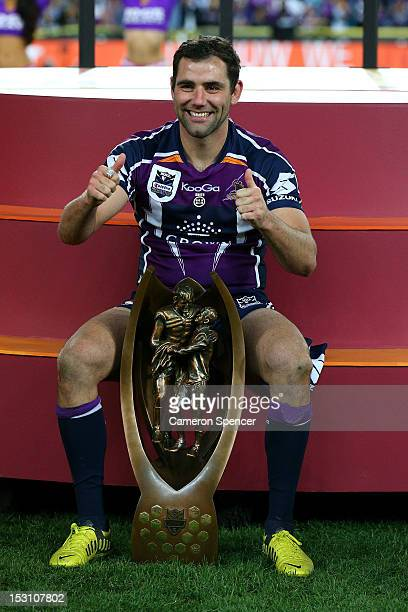 Cameron Smith of the Storm celebrate on the podium after winning the 2012 NRL Grand Final match between the Melbourne Storm and the Canterbury...