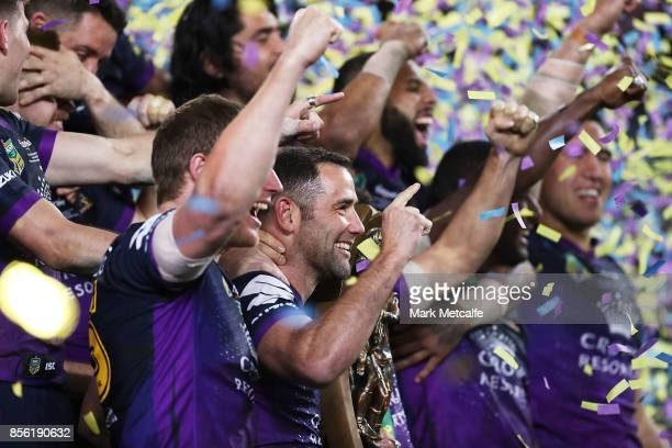 Cameron Smith of the Storm celebrates with the NRL Premiership trophy after winning the 2017 NRL Grand Final match between the Melbourne Storm and...