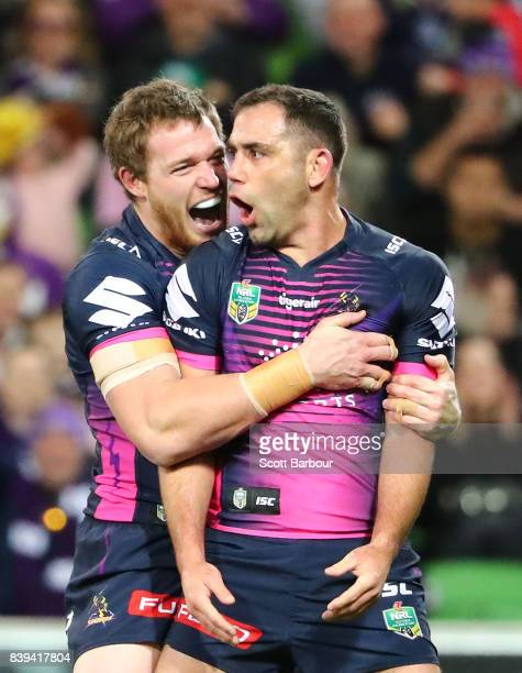 Cameron Smith of the Storm celebrates with Tim Glasby after scoring a try during the round 25 NRL match between the Melbourne Storm and the South...