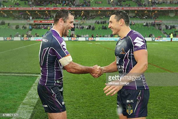 Cameron Smith of the Storm in his club record 263rd game and Billy Slater in his 250th game celebrate their win during the round two NRL match...