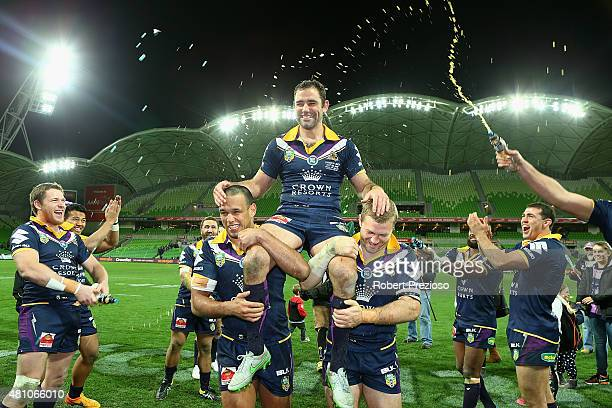 Cameron Smith of the Storm is chaired off after playing his 300th game during the round 19 NRL match between the Melbourne Storm and the Penrith...