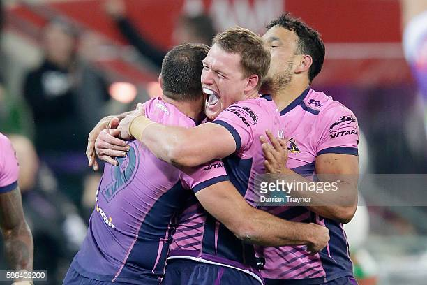 Cameron Smith of the Storm is swamped by team mates after scoreing the golden point to win the round 22 NRL match between the Melbourne Storm and the...