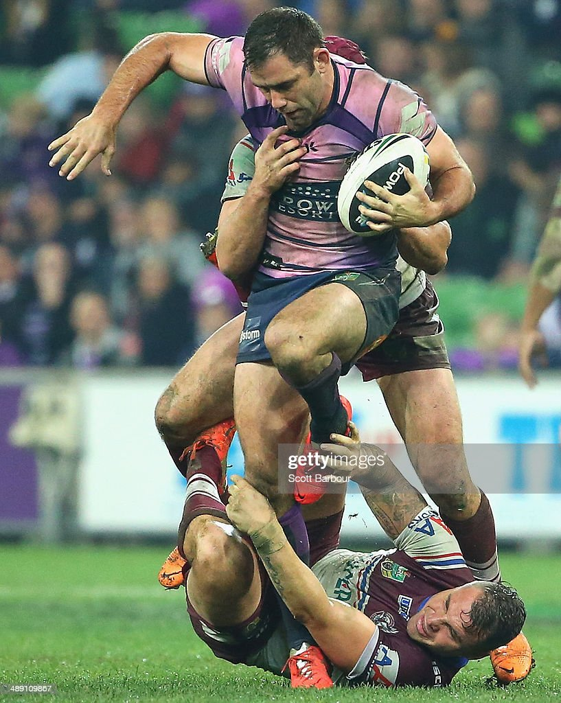<a gi-track='captionPersonalityLinkClicked' href=/galleries/search?phrase=Cameron+Smith+-+Rugby+League+Player&family=editorial&specificpeople=453295 ng-click='$event.stopPropagation()'>Cameron Smith</a> of the Storm is tackled during the round nine NRL match between the Melbourne Storm and the Manly-Warringah Sea Eagles at AAMI Park on May 10, 2014 in Melbourne, Australia.