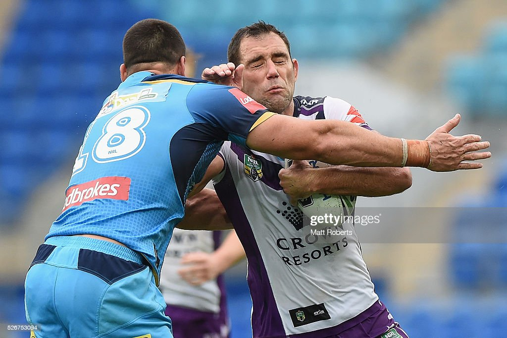 Cameron Smith of the Storm is tackled during the round nine NRL match between the Gold Coast Titans and the Melbourne Storm on May 1, 2016 in Gold Coast, Australia.