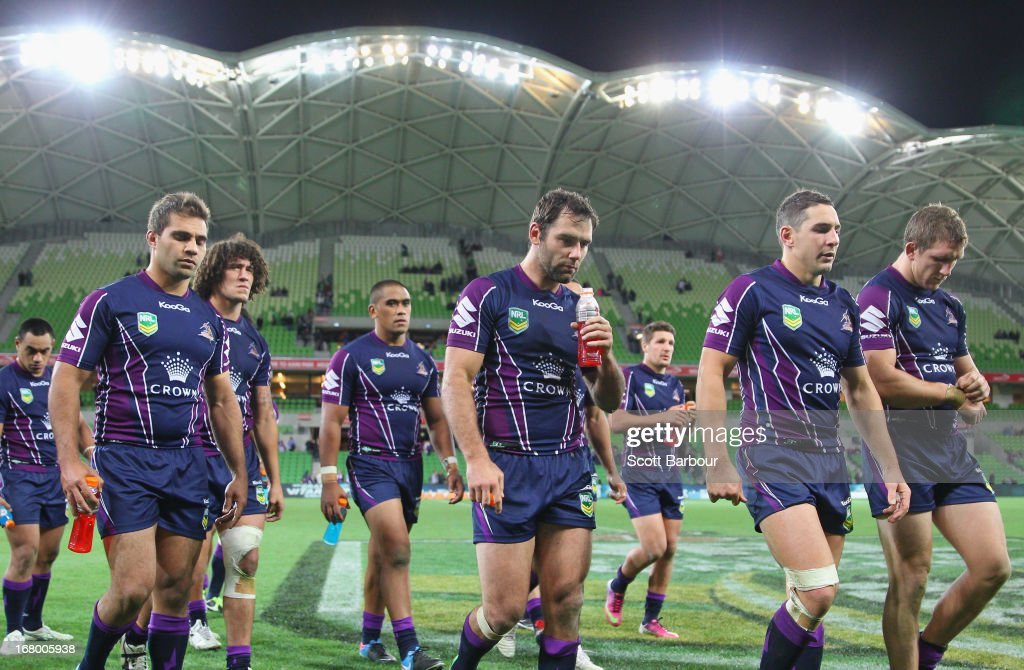 <a gi-track='captionPersonalityLinkClicked' href=/galleries/search?phrase=Cameron+Smith+-+Rugby+League+Player&family=editorial&specificpeople=453295 ng-click='$event.stopPropagation()'>Cameron Smith</a> of the Storm leads his team from the field after losing the round eight NRL match between the Melbourne Storm and the Canberra Raiders at AAMI Park on May 4, 2013 in Melbourne, Australia.
