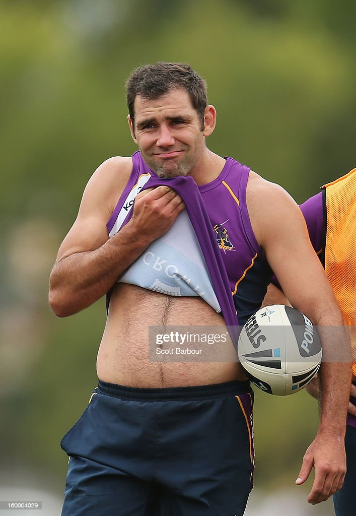 <a gi-track='captionPersonalityLinkClicked' href=/galleries/search?phrase=Cameron+Smith+-+Rugby+League+Player&family=editorial&specificpeople=453295 ng-click='$event.stopPropagation()'>Cameron Smith</a> of the Storm looks on during a Melbourne Storm NRL training session at Gosch's Paddock on January 25, 2013 in Melbourne, Australia.