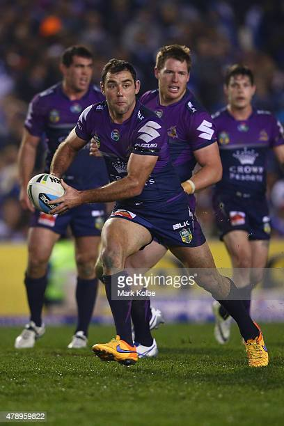 Cameron Smith of the Storm looks to pass during the round 16 NRL match between the Canterbury Bulldogs and the Melbourne Storm at Belmore Sports...