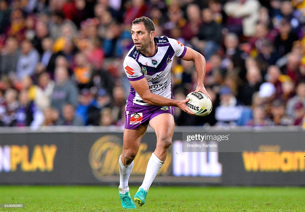 <a gi-track='captionPersonalityLinkClicked' href=/galleries/search?phrase=Cameron+Smith+-+Rugby+League+Player&family=editorial&specificpeople=453295 ng-click='$event.stopPropagation()'>Cameron Smith</a> of the Storm looks to pass during the round 17 NRL match between the Brisbane Broncos and the Melbourne Storm at Suncorp Stadium on July 1, 2016 in Brisbane, Australia.