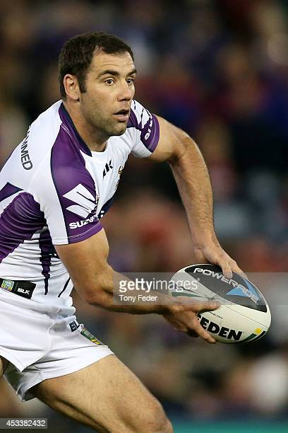 Cameron Smith of the Storm looks to pass the ball during the round 22 NRL match between the Newcastle Knights and the Melbourne Storm at Hunter...