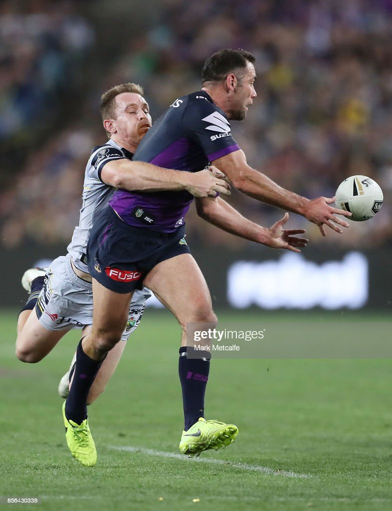 Cameron Smith of the Storm offloads as he is tackled by Michael Morgan of the Cowboys during the 2017 NRL Grand Final match between the Melbourne Storm and the North Queensland Cowboys at ANZ Stadium on October 1, 2017 in Sydney, Australia.
