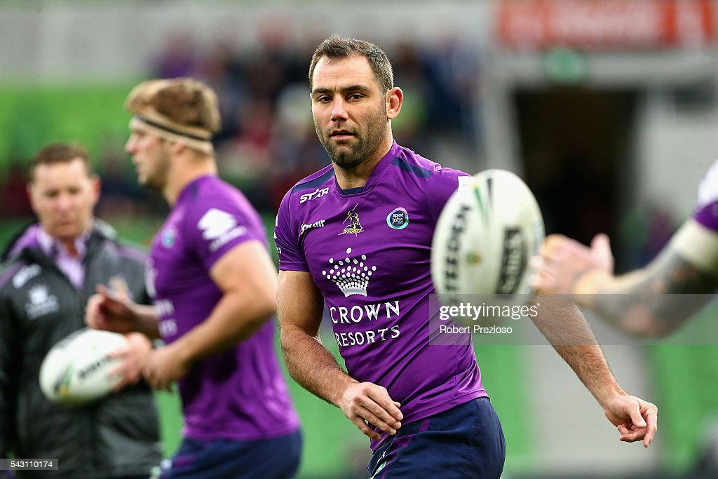 <a gi-track='captionPersonalityLinkClicked' href=/galleries/search?phrase=Cameron+Smith+-+Rugby+League+Player&family=editorial&specificpeople=453295 ng-click='$event.stopPropagation()'>Cameron Smith</a> of the Storm offloads the ball during warm up prior to the round 16 NRL match between the Melbourne Storm and Wests Tigers at AAMI Park on June 26, 2016 in Melbourne, Australia.